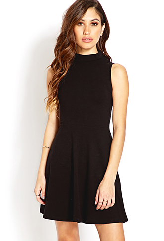 The only dress I own is from my prom,almost five years ago!  I really needed one, specifically a black dress, because I love wearing black. I love this dress, it has a keyhole back, and a mock neck.