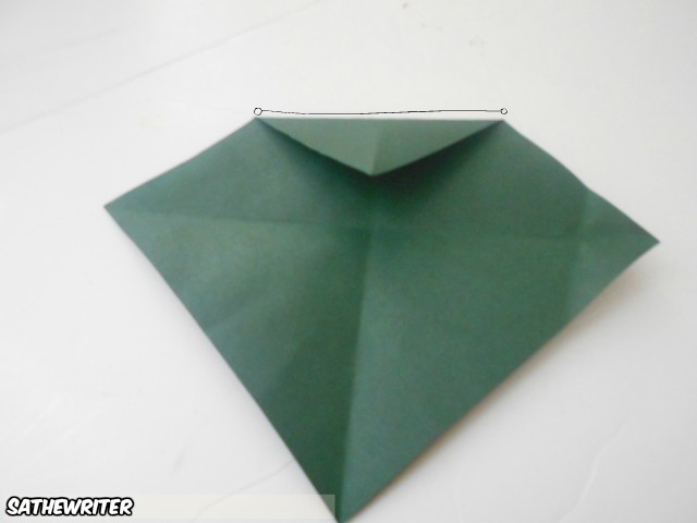 Fold the top point to the center of your paper
