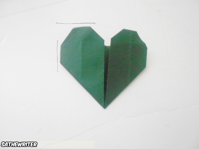 Now fold the tops of your hearts and the sides. I taped my finished heart so it wouldn't come apart but that is optional.